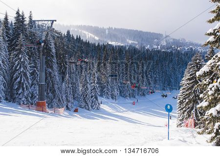 Kopaonik, Serbia - January 22, 2016: Ski resort Kopaonik, Serbia, people on the ski lift ,mountains, houses and buildings panorama