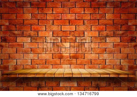 Empty wooden shelf on red brick wall background. For display or montage your products.