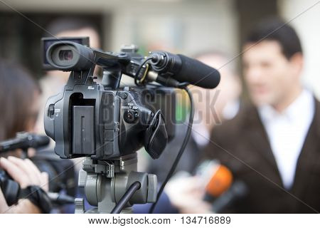 Filming an event with a video camera. Media interview.