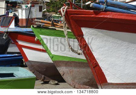 Fishing boats drawn up on beach and slipway at Camara de Lobos in Madeira Portugal