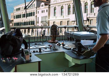 Venice Urban Steamboat Driver in Cabin Italy