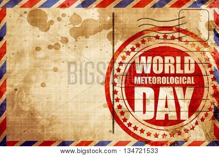 world meteorological day, red grunge stamp on an airmail backgro
