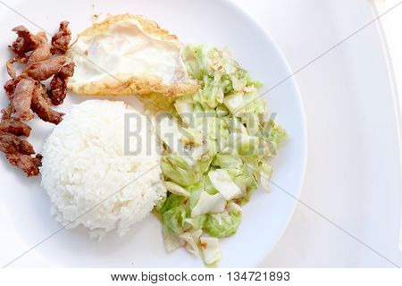 Stir-fried Cabbage With Fish Sauce, Fired Pork , Fired Egg With Fish Sauce  In The White Plate
