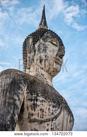 Close up of Buddha statue in Sukothai historical park Wat Mahatat Thailand