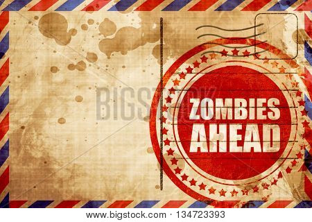 zombies ahead, red grunge stamp on an airmail background