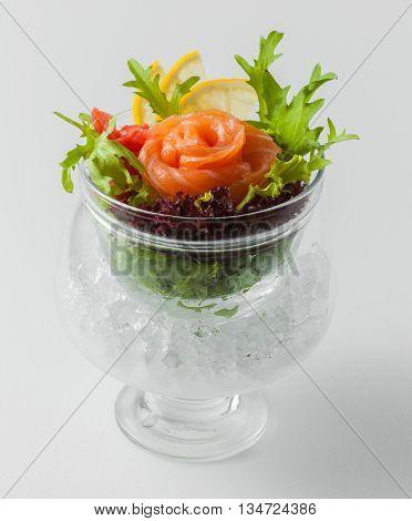 Sashimi with salmon herbs and lemon slices