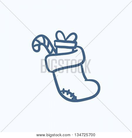 Christmas boot with gift and candy cane vector sketch icon isolated on background. Hand drawn Christmas boot with gift and candy cane icon. Christmas boot sketch icon for infographic, website or app.