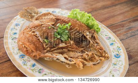 closed up the deep fried snapper fish with fish sauce