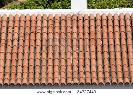 Background ornament terracotta red tiles on roof in Tenerife, Canarian islands