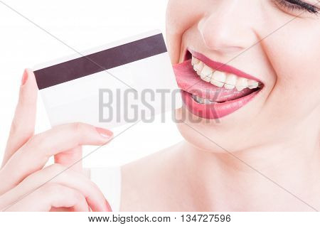Close-up Of Woman Licking A Credit Debit Card