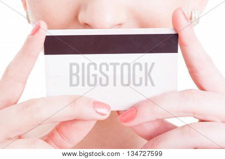 Woman Holding Credit Debit Card In Front Of The Mouth