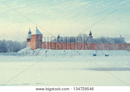 Architecture landscape - winter panoramic view of Novgorod architecture - Kremlin towers near the Volkhov river in cold mist in Veliky Novgorod Russia architecture landmark vintage tones applied