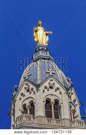 LYON, FRANCE - MAY 24, 2015: Statue of Our Lady decorates the bell tower dome of the Basilica of Notre Dame de Fourviere.
