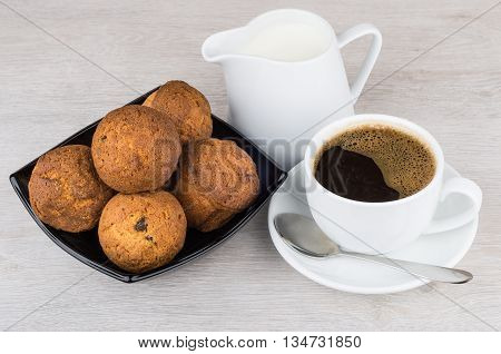 Hot Coffee, Jug Milk And Muffins In Bowl On Table
