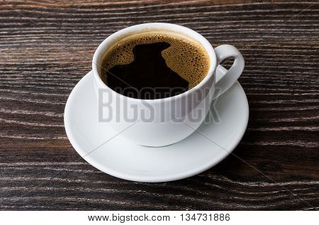 Cup Of Hot Coffee On Wooden Table