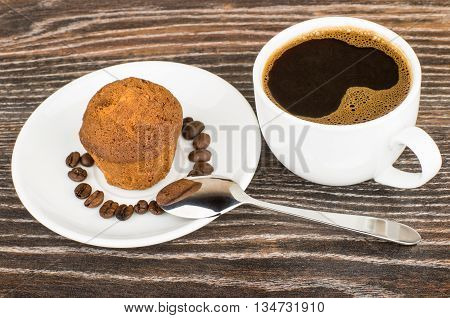 Hot Coffee And Muffins In Saucer On Table