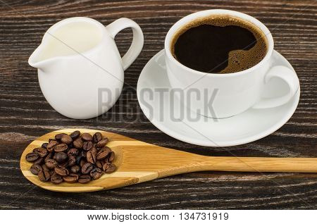 Coffee, Jug Milk And Wooden Spoon With Coffee Beans