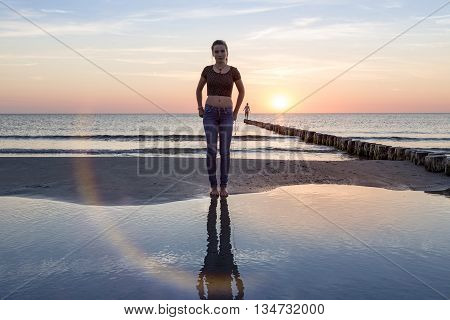 portrait of a teenage girl on the beach at sunset