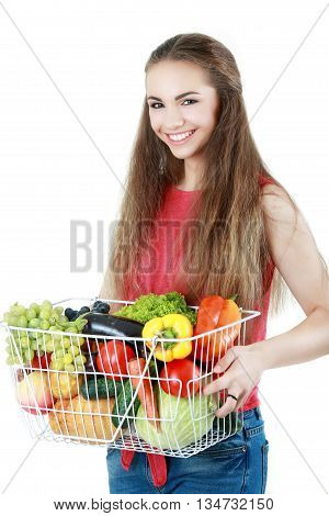 girl poses with fruit and water on white background