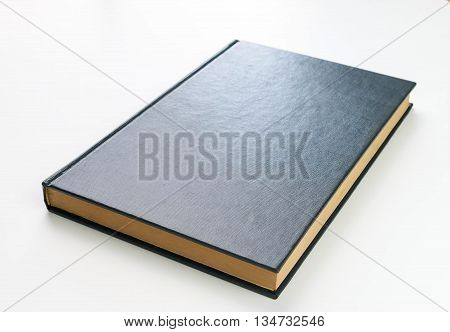 old blue cover textbook on white background