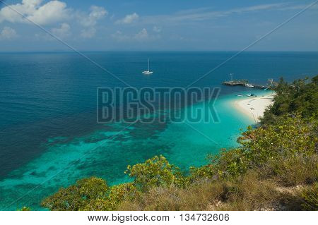 landscape of tropical island beach with perfect sky. with nice Bungalows.
