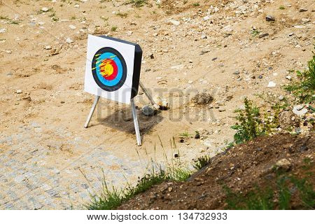 Crossbow bolts or arrows in a portable outdoor target at a shooting range in a high angle view