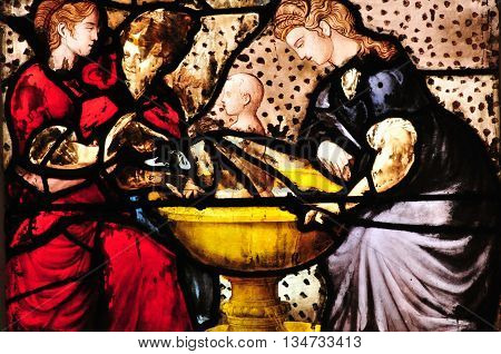 Triel sur Seine France - april 3 2016 : historical stained glass window in Saint Martin church