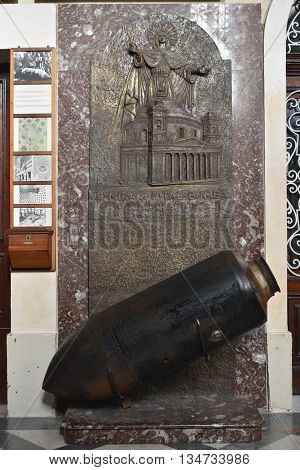 Mosta, Malta - January 28, 2016. Replica of World War II bomb in the Parish Church of Santa Maria in Mosta, Malta. On 9 June 1942 as around 300 parishioners were waiting to hear Mass, three enemy bombs struck the Mosta Dome. Two bounced off and landed in
