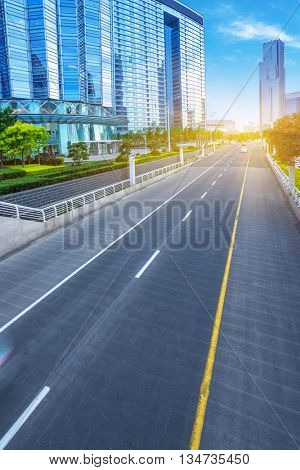motion blurred traffic with modern buildings background