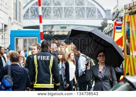 LONDON, UK - JUNE 16 2016  Fire services attend incident outside Paddington Station. Emergency services respond to derailed train at peak commuter time at one of London's busiest railway stations