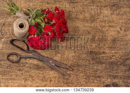 Bouquet Of Red Roses, Ball Of Twine And Old Rusty Scissors