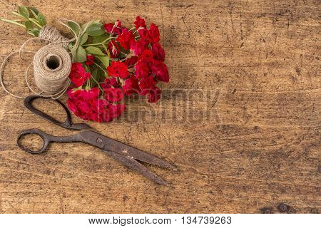 Bouquet Of Red Roses, Ball Of Twine And Rusty Scissors