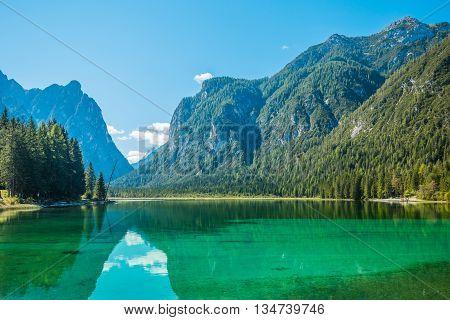 Beautiful mountain lake Dobiaco in Dolomites Alps, Italy