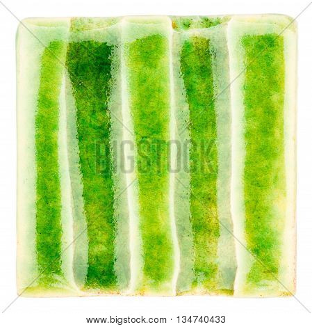 Green lined handmade glazed ceramic tile isolated on white background