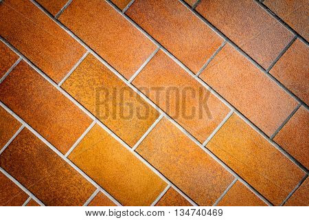 Detail of brown tile wall texture background