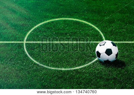 Soccer football field stadium and ball on green grass