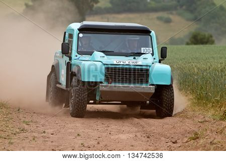 WULSTAN, UK - JULY 21: An unnamed driver climbs the steep hillside and field section during the AWDC UK Brit Part Comp Safari competition on July 21, 2013 in Wulstan.