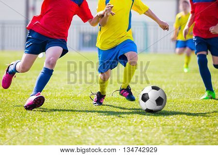 Kids Playing Soccer Football Match. Sport Soccer Tournament for Youth Teams.
