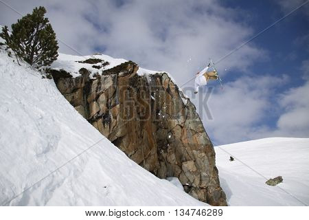 Ski rider jumping on mountains. Extreme ski freeride sport.