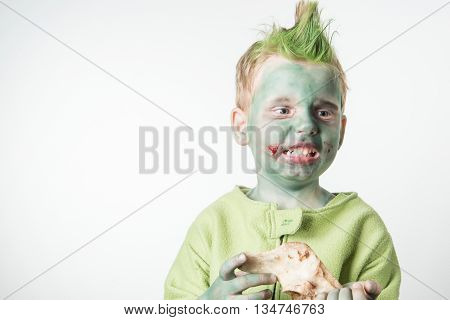 Angry little boy dressed as a zombie on halloween