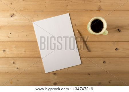 blank sheet with pencil and cup of coffee