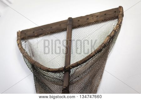 vintage fishing net with woodenstick in fisheries museum