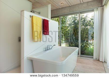 interior of new apartment, modern bathroom, bathtub