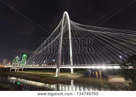 DALLAS USA - APR 8: The Margaret Hunt Bridge over the Trinity River in Dallas illuminated at night. April 8 2016 in Dallas Texas USA