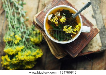 Romantic Background With Cup Of Tea, Flowers And Open Book Over