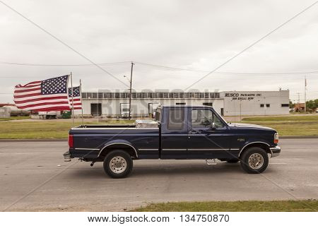 DALLAS USA - APR 9: 1997 Ford F-150 XLT Crew Cab with national flags of United States of America. April 9 2016 in Dallas Texas United States