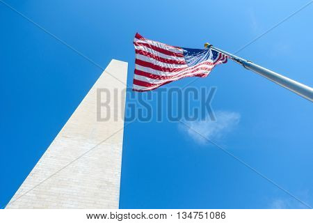 The Washington Monument and the flag of the United States of America