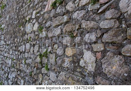 Ancient stone wall in a country of Sabina in Italy