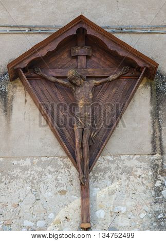 Wooden sculpture depicting Jesus Christ on the cross