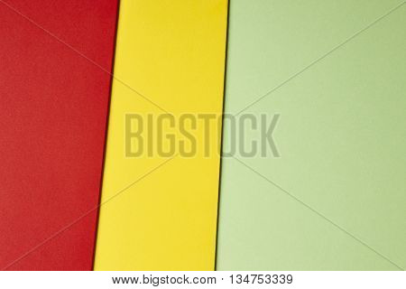 Colored cardboards background in green yellow red tone. Copy space. Horizontal
